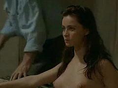 Emmanuelle Beart removing her robe to reveal her fully ...