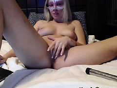 Masked blonde girl on the bed