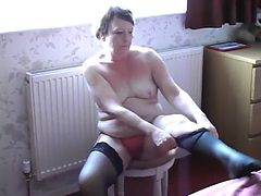 Exhibitionist MILF Getting Dressed in Front of the Window