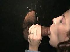 Black cock fucks white pussy through gloryhole