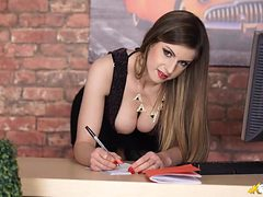 Hot secretary babe bends over to tease her cleavage