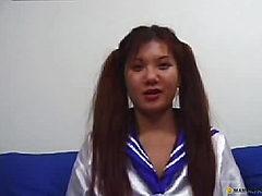 Asian girl sitting in school suit