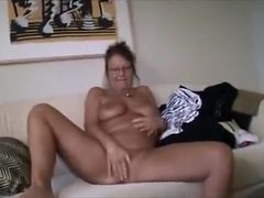Chubby blonde milf shows off her big tits and wet pussy...