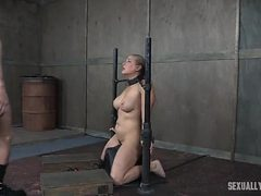 Couple takes turns dominating a chained up slave girl