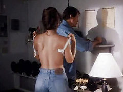 Ashley Laurence removing her bra and laying back as a g...