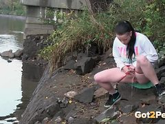 Down by the river a pretty chick goes pee