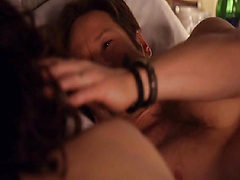 Carla Gugino naked lying on her stomach on a bed, propp...