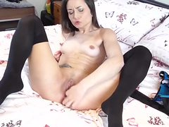 Lithe beauty sensually rubs her perfect pussy