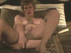 Old classy slut fucks herself with pantyhose