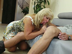 Old and busty blonde granny pleases a younger partner