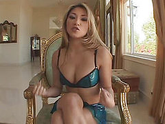 Girl with a beautiful body bends near the chair