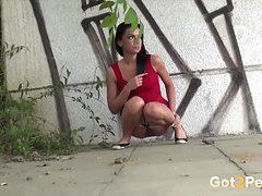 Red dress girls take a pee in public