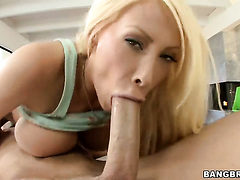 Blonde Candy Manson with huge breasts and smooth beave...