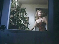 Traci Lords first seen standing in the nude as she towe...