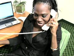 Ebony shemale secretary strips off while having a phone...
