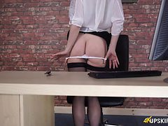 Secretary in a sheer blouse and hot stockings