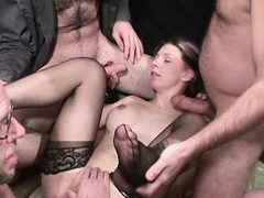 Dirty slut gets soaked in piss and cum by several guys ...