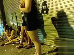 Drunk bimbos walk around the town in rather revealing c...