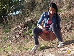 Spandex leggings on a girl pissing outdoors