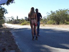 Exhibitionist blonde milf in an abandoned road