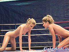 Lesbian babes wrestling while oiledup