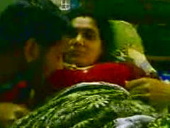 Mature Indian aunty obediently sucks dick of her young ...