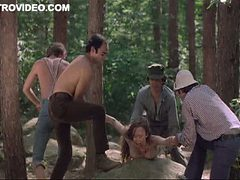 Four Horny Lumberjacks Abuse Camille Keaton Outdoors In...
