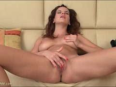Mom with nice natural tits masturbates her hot cunt