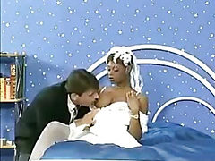 Ebony bride gets the groom and another hard cock in a t...