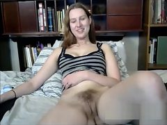 Horny Teen dildoing hairy pussy
