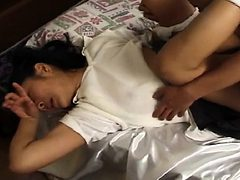 Innocent young Asian chick in a school uniform gets dri...